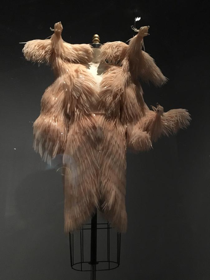 Manus x Machina – Feathers and ArtificialFlowers